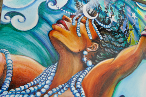 Yemayah – A powerful Yoruba Orisha, or goddess. Long ago in Africa, she was the symbol of rivers and sweet waters, fertility and life, the mother of all life forms. She wore clear beads, and was a symbol of transformation. During the Middle Passage, she became the mother of the oceans and salt water, and acquired blue beads.